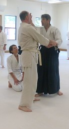JohnC uses Zach to demonstrate a technique.