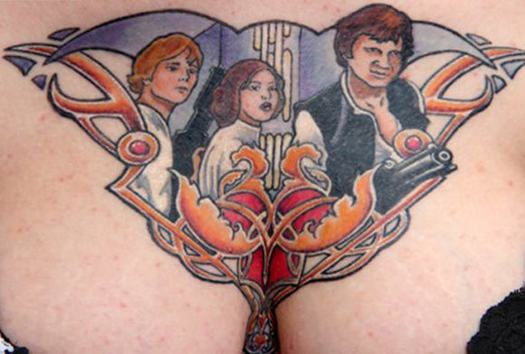 Luke Skywalker Princess Leah Hans Solo tattoos on boobs Bad Star Wars Tattoos, Worst Star Wars Tattoos, ugliest tattoos, funny tattoos, star wars convention, ugliest tattoos, worst tattoos in america, stupid people, funny pictures, wtf, fail, crazy, horrible, terrible, regrettable, regrets, awful ugly