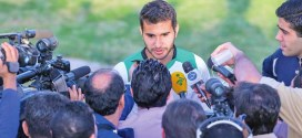 Mehrdad Beitashour amongst the media.