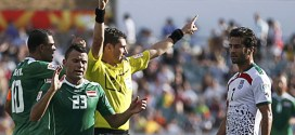 Referee Benjamin Williams of Australia shows the red card following a second yellow card to Iran's Mehrdad Pooladi next to Iraq players as Iran's Masoud Shojaei reacts during their Asian Cup quarter-final soccer match at the Canberra stadium in Canberra