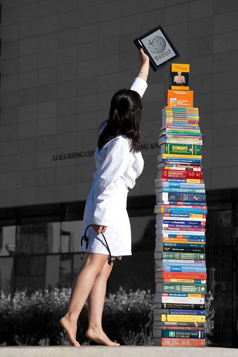 A photo taken by my former classmate, now Dr. Lai, illustrating all of the books it takes to make a physician.