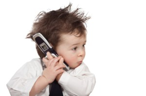 Are mobile phones safe : its effect on people , a spiked hair kid holding a phone