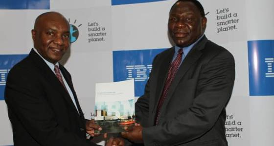 PHOTO: Tony Mwai IBM CGM and Dr. Bitange Ndemo PS ministry if information showing the white paper at the event.