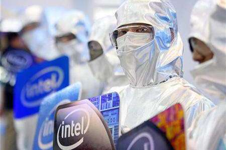 Men dressed in laboratory suits pose at the Intel booth during the 2009 Computex exhibition in Taipei