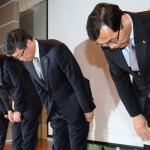 SK Telecom CEO Ha Sung-min (second from right) and company executives bow during a public apology for the mobile operator's service failure at its headquarters in Seoul on Friday. (Yonhap)