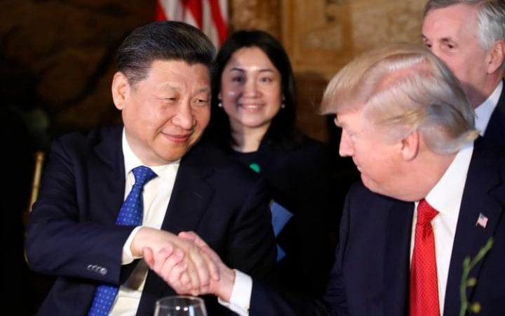 Donald Trump and Xi Jinping shake hands during the Chinese president's visit to the US