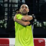 226 Baghdatis hugs himself