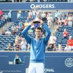 25-Djokovic holds trophy over his head