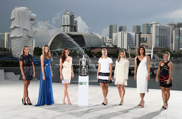 SINGAPORE - OCTOBER 21: The 2016 BNP Paribas WTA Finals Singapore presented by SC Global returns to Singapore for the third consecutive year with the top women competing for $7 million in prize money from October 23 to October 30. This year's singles field poses with the Billie Jean King Trophy at Merlion Park overlooking Marina Bay in Singapore. Left to Right: Madison Keys (USA), Karolina Pliskova (CZE), Agnieszka Radwanska (POL), Angelique Kerber (GER), Simona Halep (ROU), Garbine Muguruza (ESP), Dominika Cibulkova. The last remaining spot for the final qualifier is yet to be determined. (Photo by Julian Finney/Getty Images) *** Local Caption *** Madison Keys;Karolina Pliskova;Agnieszka Radwanska;Angelique Kerber;Simona Halep;Garbine Muguruza;Dominika Cibulkova