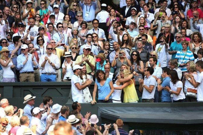 Marion Bartoli hugs her Fed Cup team mate Kiki Mladenovic after winning her first Slam at Wimbledon