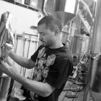 Photo by Mario Bartel Wong weighs Perle hop pellets that will be added to one of the 1,700 litre brewhouse tanks.