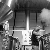 Photo by Mario Bartel Wong checks the progress of the beer brewing in one of two 1,700 litre brewhouse tanks.