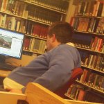 Patch Editor Paul Devlin working at New Canaan Library
