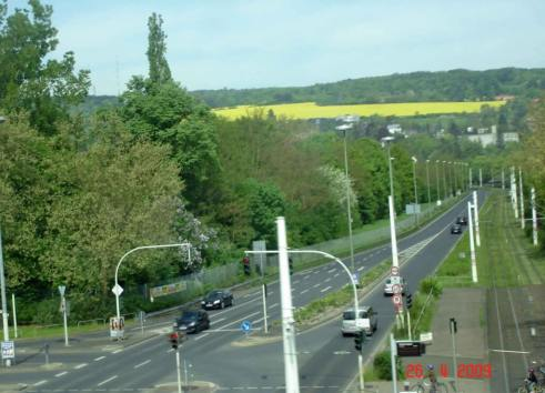 View-from-autobahn-Frankfurt to Wurzburg undulating green hills bright yellow crops
