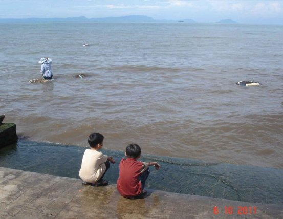 Beachside - young children wait anxiously on the seashore -Seasfood Market,