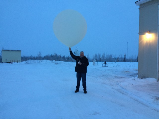 Robin about to release a weather balloon in Inuvik