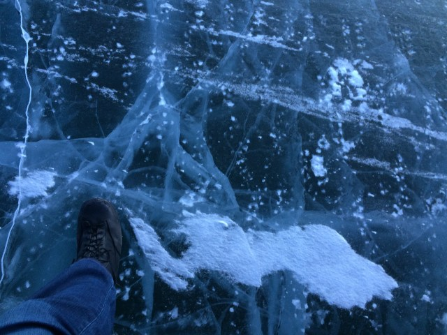 On the ice road to Tuk. Robin's foot on the ice road from Inuvik to the Beaufort Sea.