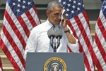 Associated Press/Charles Dharapak - President Barack Obama wipes perspiration from his face as he speaks about climate change