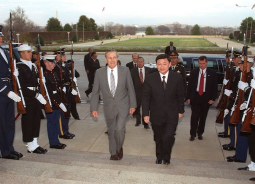 Secretary of Defense Donald H. Rumsfeld escorts visiting Prime Minister Thaksin Shinawatra, of Thailand