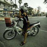 Thai PM urges motorcycle riders to wear helmets