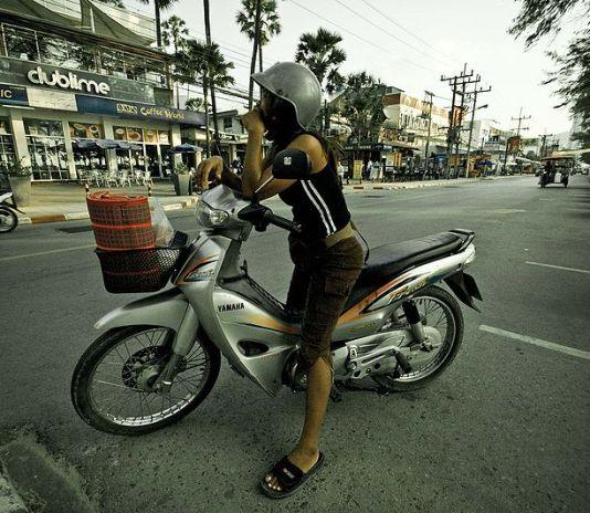 Thai girl riding a motorcycle