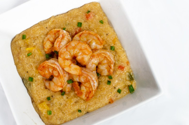 A one-pot shrimp and grits recipe that packs a spicy Sriracha punch.