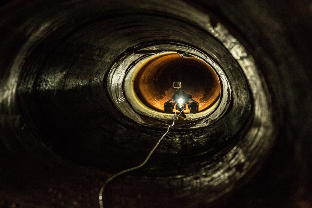 An unmanned robot with a video camera travles down a tunnel near the Mexican border in Nogales, AZ. The robot is used in tunnels that are normally to small or unsafe for someone to crawl down.