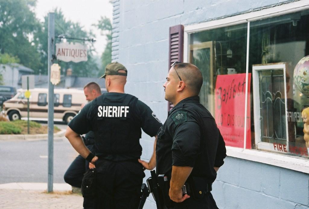 SWAT team officers keeping an eagle eye on biker hoodlums.