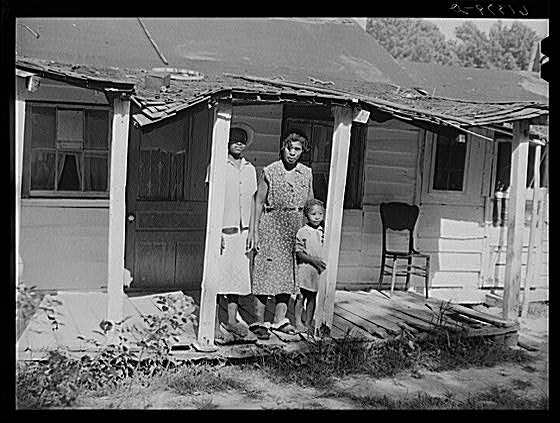 Mrs. Calip White and children on porch in 30s in Ridge, Md.
