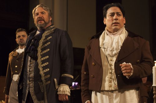 "Hugo Vera as Spoletta, Thomas Woodman as Scarpia and Edgar Jaramillo as Mario Cavaradossi in a scene from Chelsea Opera's ""Tosca"" (Photo credit: Robert J. Saperstein)"