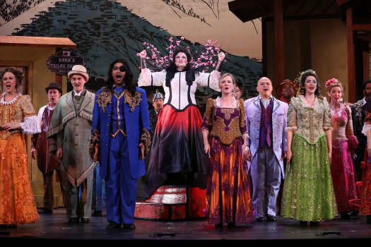 "Cáitlín Burke as Katisha and company in the first act finale of New York Gilbert & Sullivan Players' new production of ""The Mikado"" (Photo credit: Carol Rosegg)"
