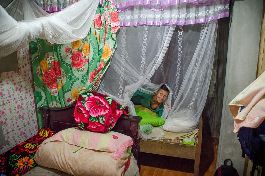 Ashlie peeking out of the mosquito net of our homestay in Ta Van Village, Vietnam.