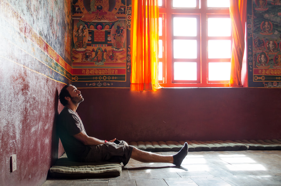Adrian relaxing and taking in the peaceful surrounding of a gompa in Muktinath, Nepal