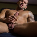 Gay Porn Star Tyler Wolf fingers his tight hole