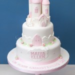 Two tier tower cake in pink.