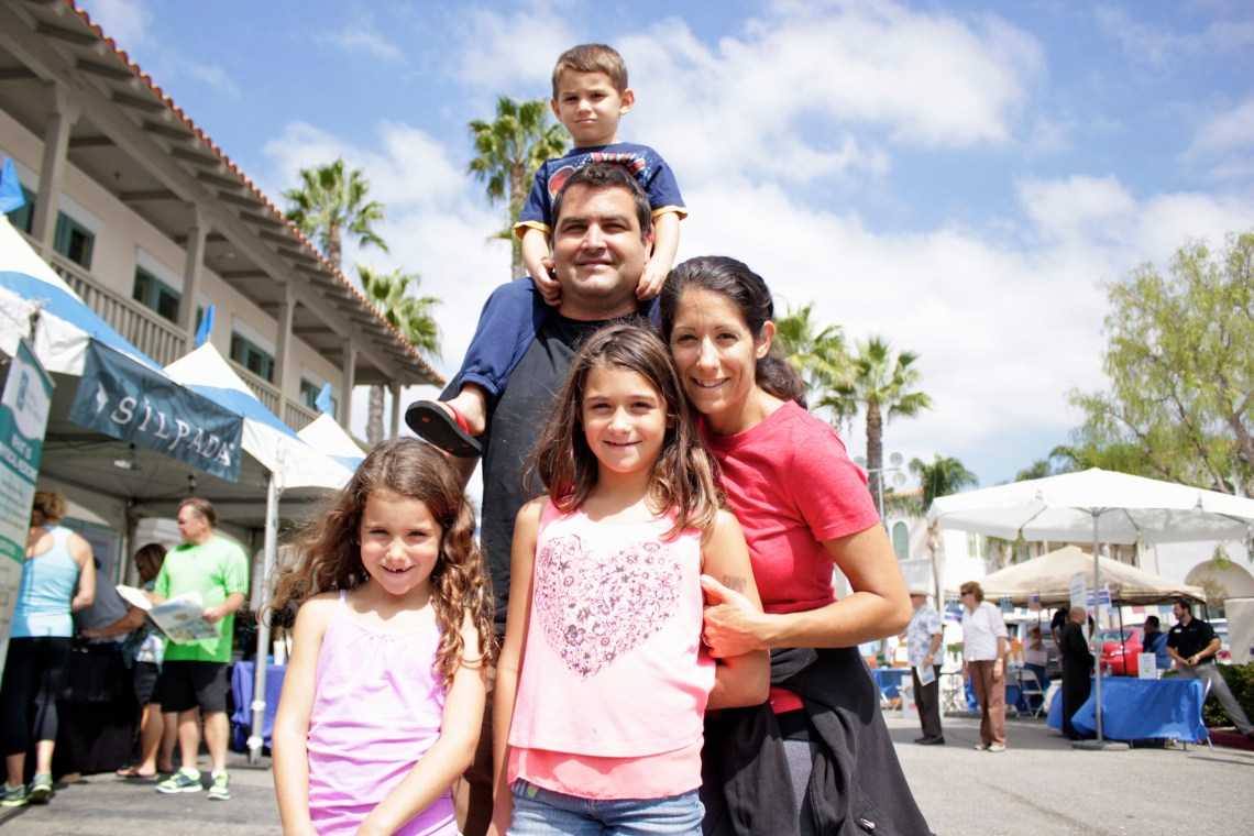 The Cestone family of San Juan Capistrano stroll through the fair grounds. Photo by Brian Park