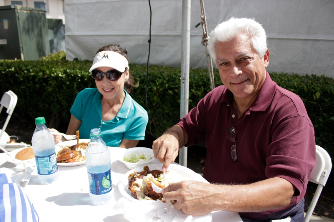 Theresa Gonsalves of Las Palmas and Dan Gelfand of Cerritos enjoy a traditional meal during the Greek Festival. Photo by Brian Park