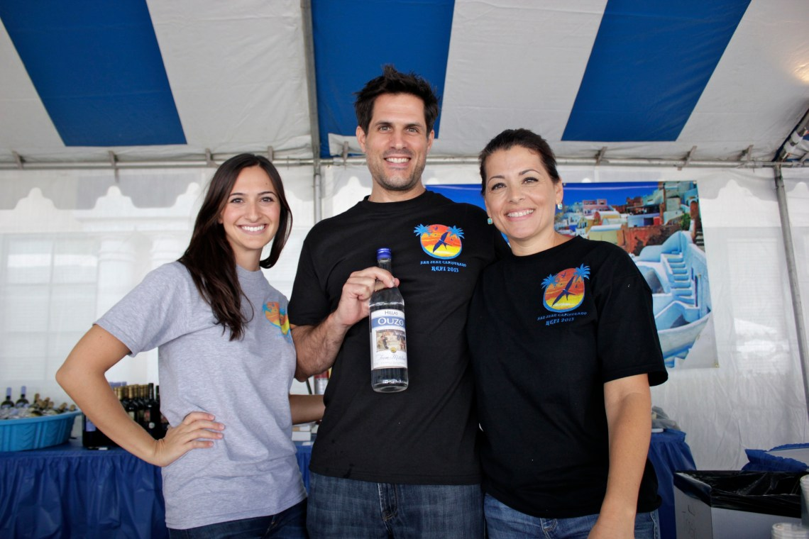 (From L to R) Mary Parlapanides, Vlas Parlapanides and Mia Domingot served guests authentic Greek beer and liquor, including ouzo, during the Greek Festival. Photo by Brian Park