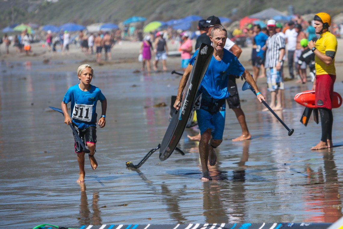 Racers had to make their way to the start and finish lines on the beach at the Battle of the Paddle. Photo: Tony Tribolet/www.xpsphoto.com