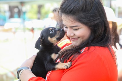Lauren Ramirez, of Palmdale, bonds with a 9-week-old puppy up for adoption from Doggie Bonez rescue. Photo: Allison Jarrell