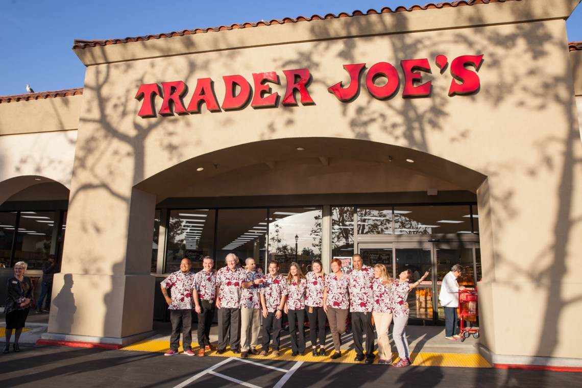 Trader Joe's crew members gather for a photo before the grand opening ceremony. Photo: Allison Jarrell