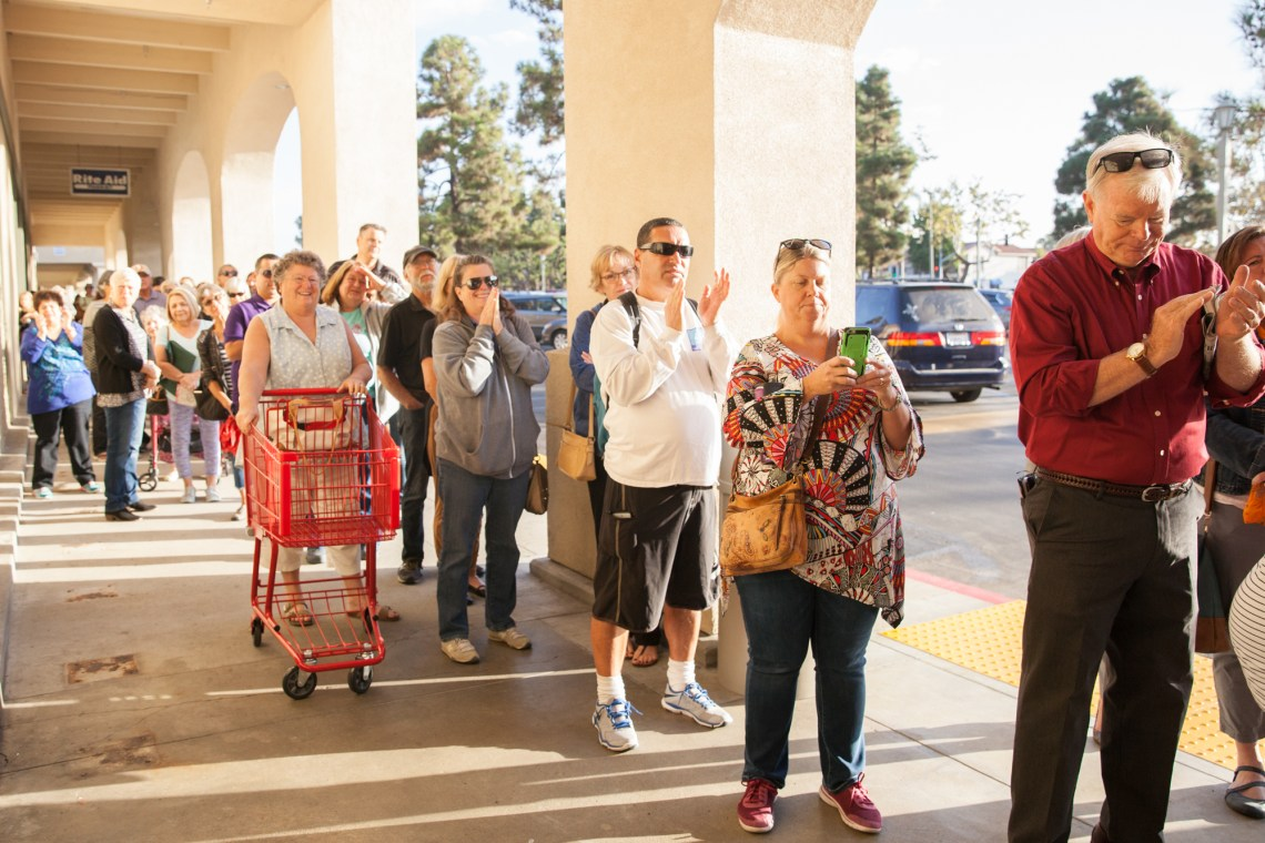 Community members applaud during the Oct. 11 grand opening for Trader Joe's. Photo: Allison Jarrell