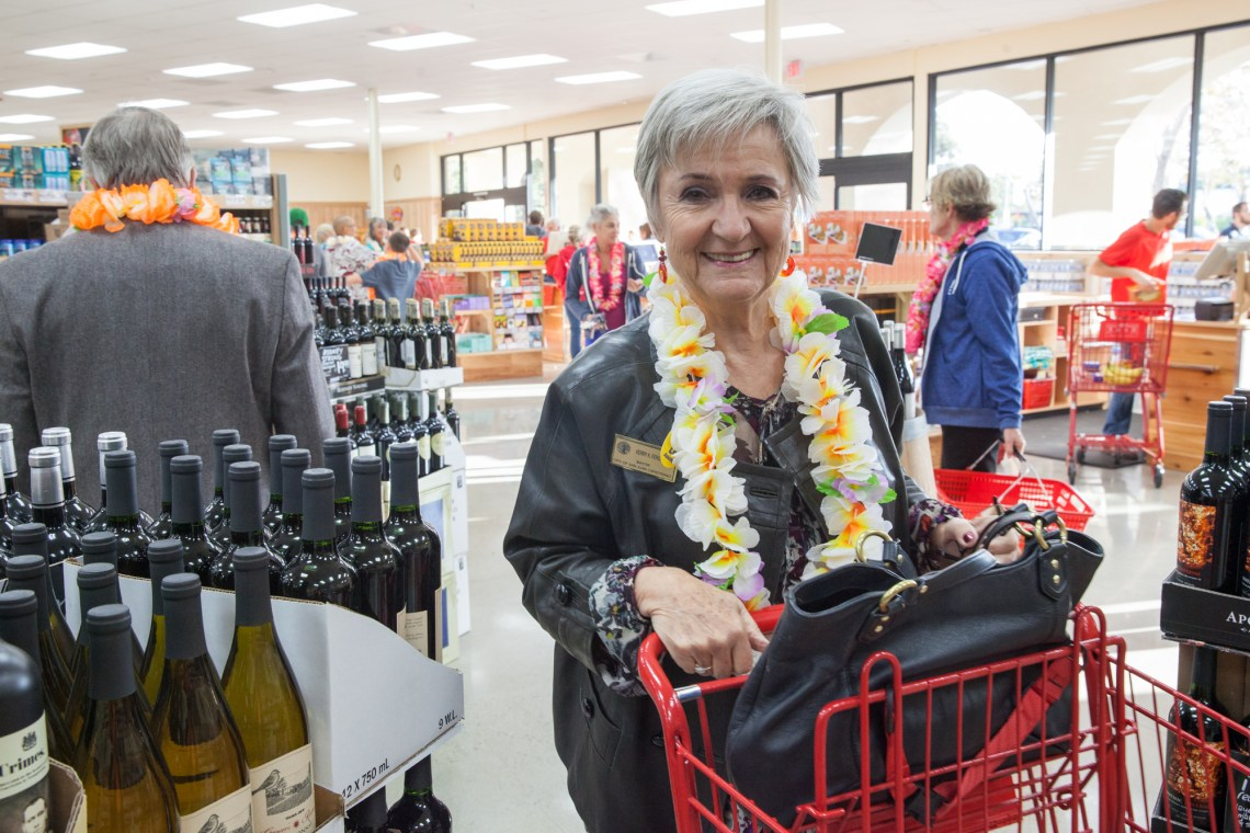 Mayor Kerry Ferguson does some shopping during the Trader Joe's grand opening. Photo: Allison Jarrell