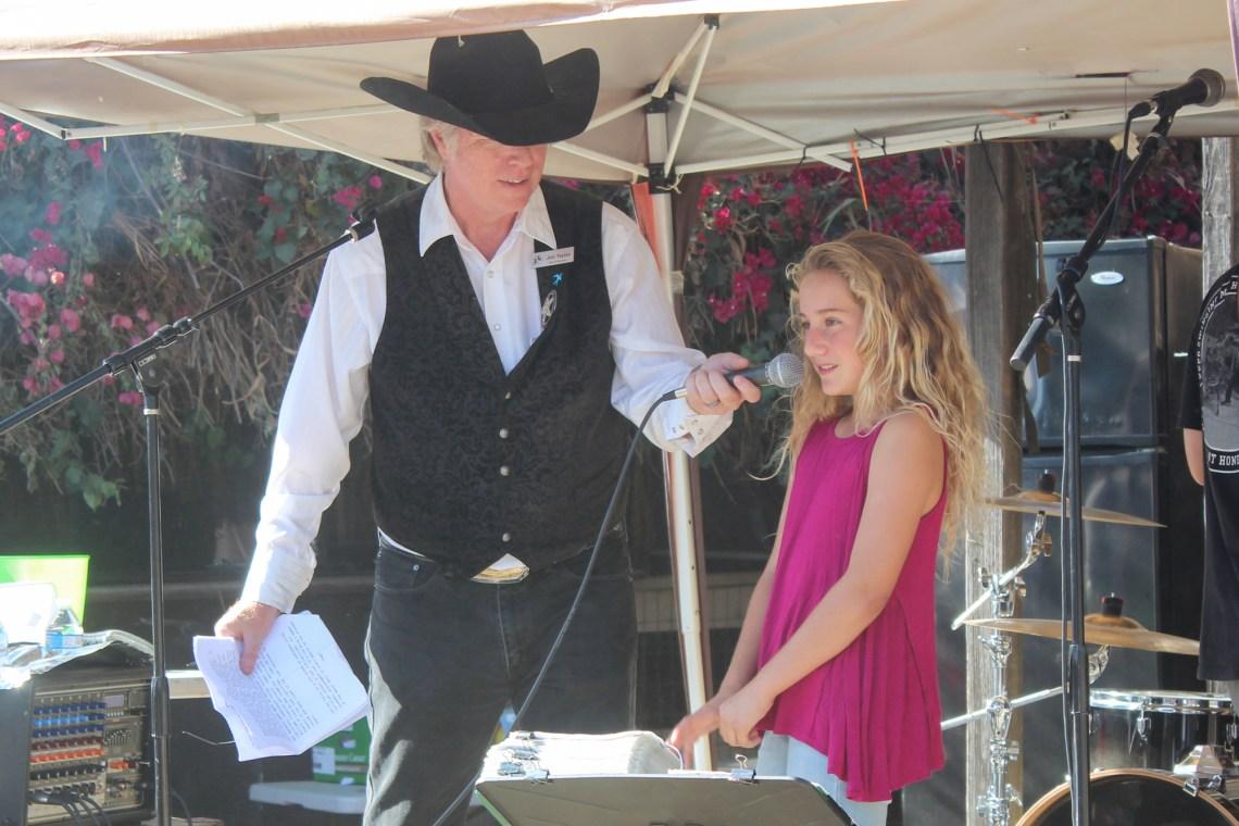 Fiesta President Jim Taylor introduces Jr. Miss Fiesta Addison Williams, a fifth grader at Saddleback Valley Christian School. Photo: Rachael Garcia