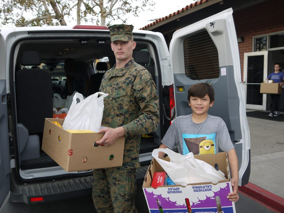 Marine Corps representatives collect meals packed by SJC Rotary Club members for families of the 1st Battalion, 11th Marines during last year's Thanksgiving food drive. Photo: John Caldwell