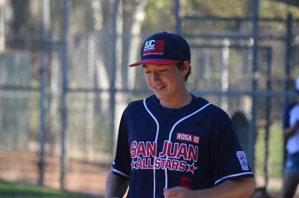 "A Little League player wears a ""Rosa 10"" badge. Photo: Emily Rasmussen"