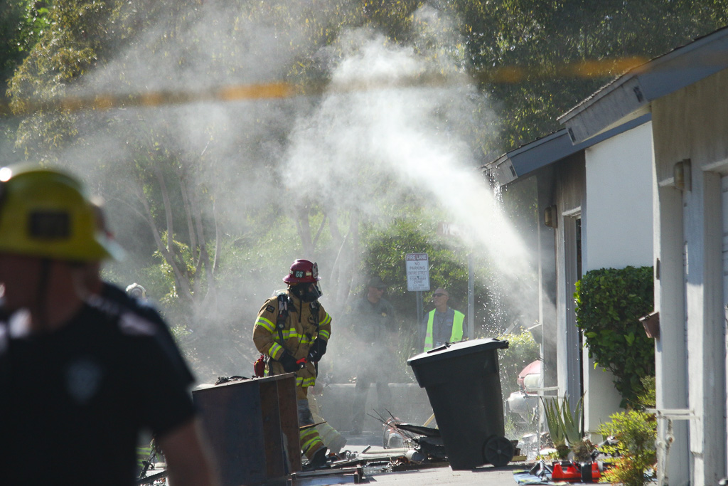 Firefighters make quick work of a blaze at a San Juan Capistrano apartment on Wednesday, Aug. 8. Photo: Eric Heinz.