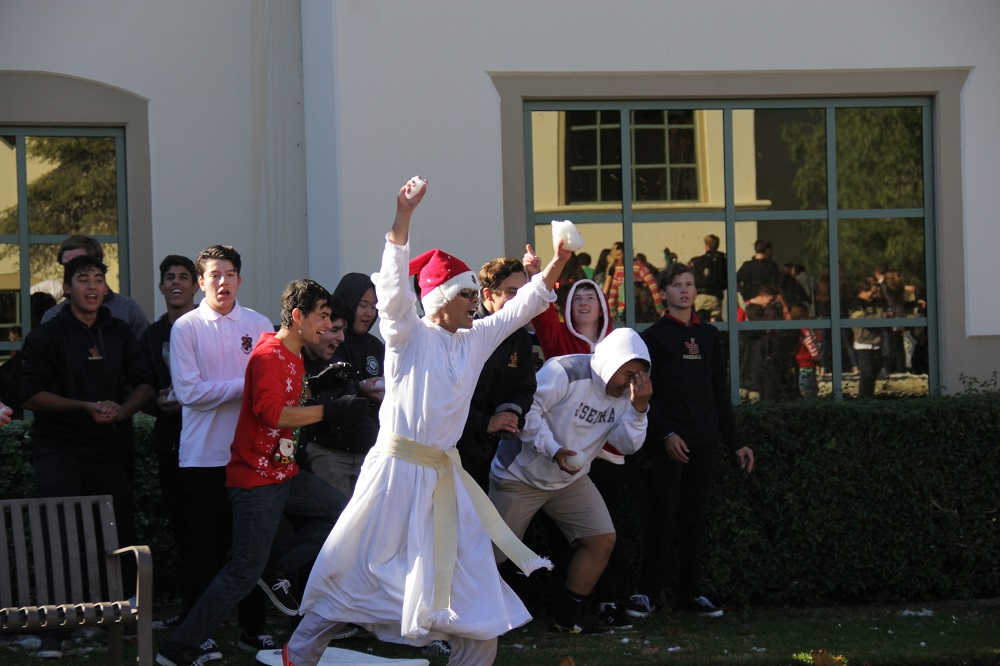 Father Damien Giap and several JSerra students prepare to charge to charge toward their next targets. Photo: Shawn Raymundo