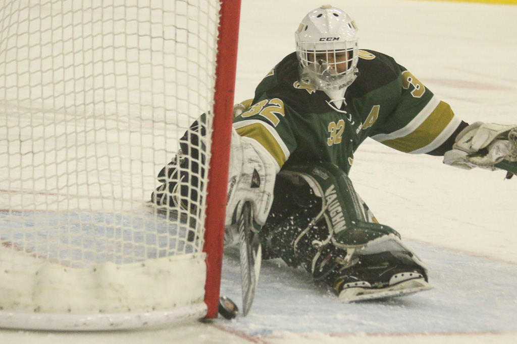 Damien High School goalie Jordan Bacani makes a kick save in the first period on Friday, Feb. 8, against JSerra Catholic High School. Bacani made multiple highlight saves in the game. Photo: Eric Heinz