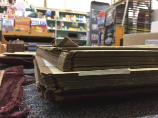 This shows the strips of board separated by the cloth hinges, allowing the pages to flex.